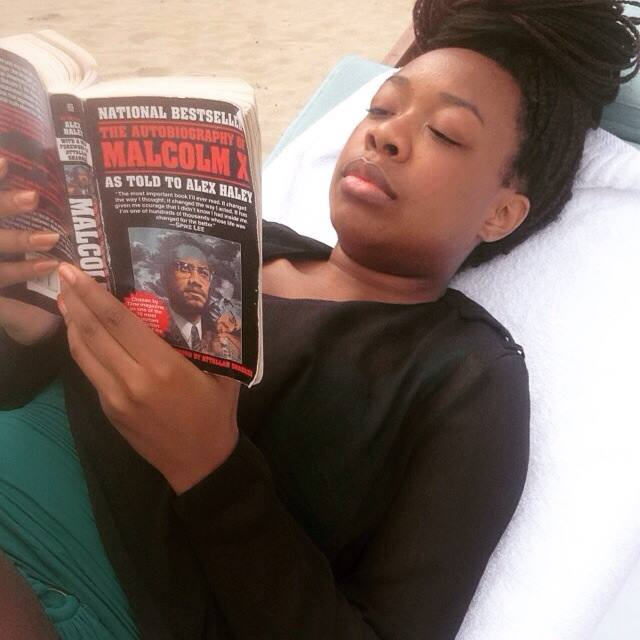 Reading in Playa Dorada, Dominican Republic and the photo credit goes to Vaneshia Reed